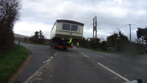 House being transported by a truck