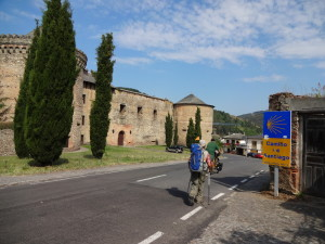 """Villafranca Castle. Michael, one of our """"Camino"""" friends can be seen riding his bicicle in this picture."""